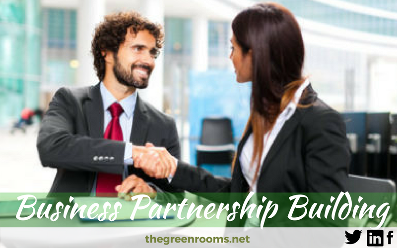 shaking hands to form Business Partnership