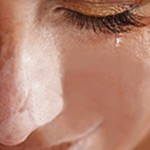 crying woman who would benefit from counselling and psychotherapy