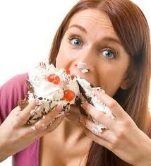 lady eating cream cake